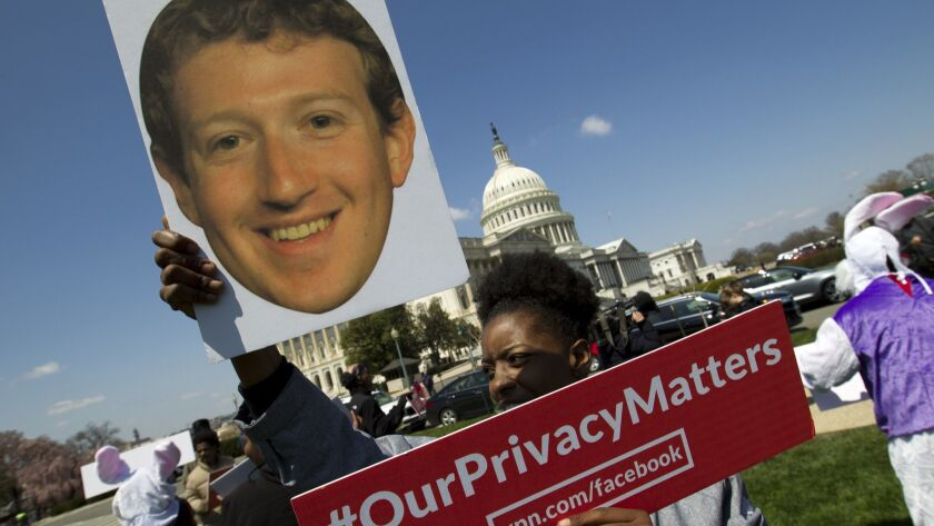 A demonstrator outside the U.S. Capitol on April 10, ahead of Facebook CEO Mark Zuckerberg's congressional testimony.