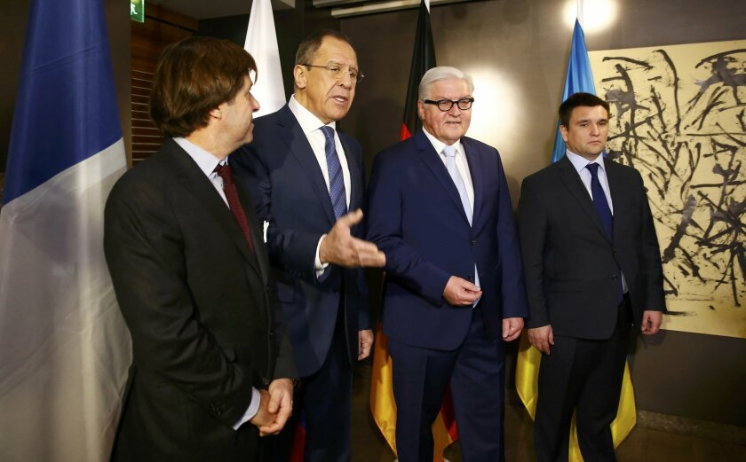 Political Director of the French Foreign Ministry Nicolas de Riviere, Russian Foreign Minister Sergey Lavrov, German Foreign Minister Frank-Walter Steinmeier and Ukrainian Foreign Minister Pavlo Klimkin, from left, pose  for the media prior to  their meeting at the Munich Security Conference in Mun