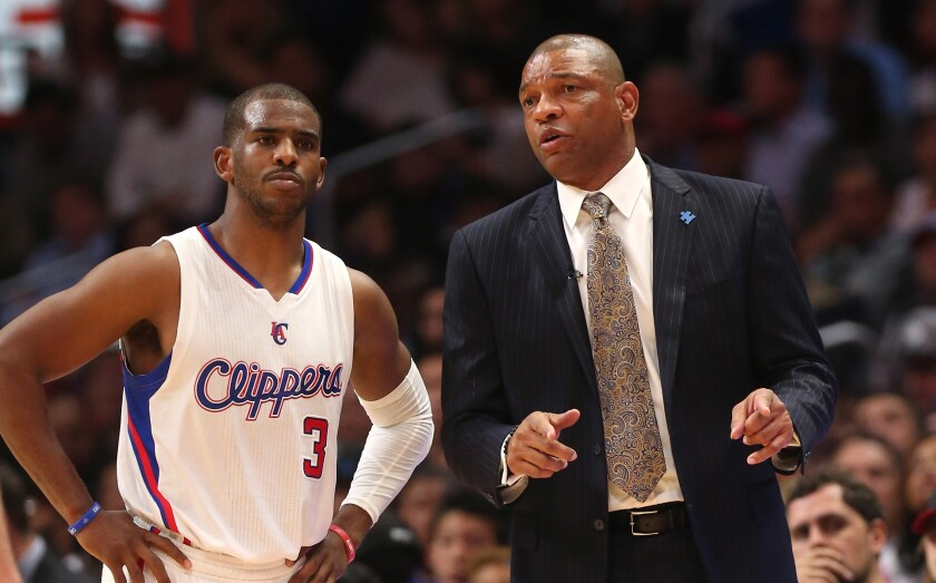Clippers guard Chris Paul, left, and coach Doc Rivers.