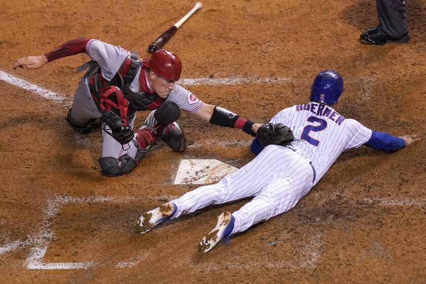 Chicago Cubs' Nico Hoerner (2) is safe at home past the tag of Cincinnati Reds catcher Tyler Stephenson during the fourth inning of a baseball game Thursday, Sept. 10, 2020, in Chicago. (AP Photo/Charles Rex Arbogast)