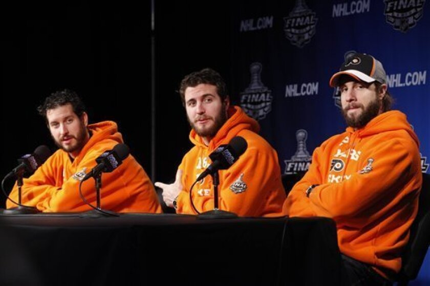 Philadelphia Flyers' Michael Leighton, left, Mike Richards and Simon Gagne are seen during a news conference in Philadelphia, Tuesday, June 1, 2010. Game 3 of the NHL hockey Stanley Cup finals between the Flyers and the Chicago Blackhawks is scheduled for Wednesday. The Blackhawks lead the series 2-0. (AP Photo/Matt Rourke)