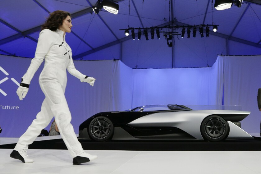 A driver walks in front of the FFZero1 by Faraday Future at CES Unveiled, a media preview event for CES International in Las Vegas in January.