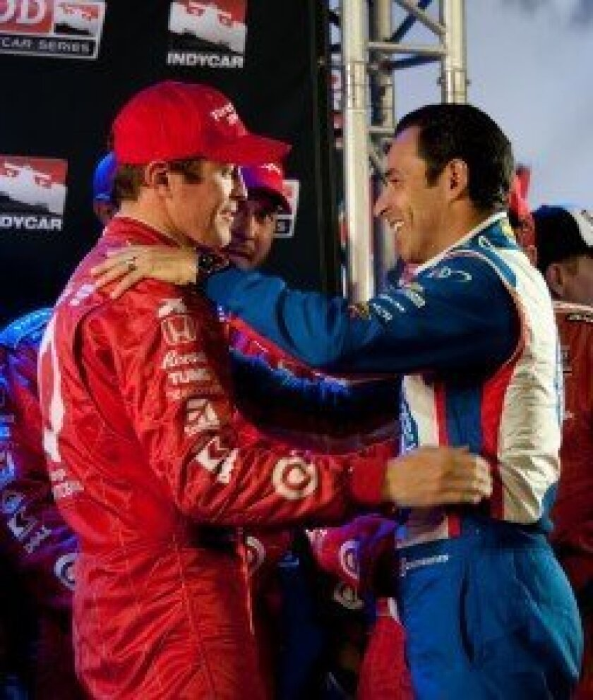 Helio Castroneves graciously congratulates Scott Dixon