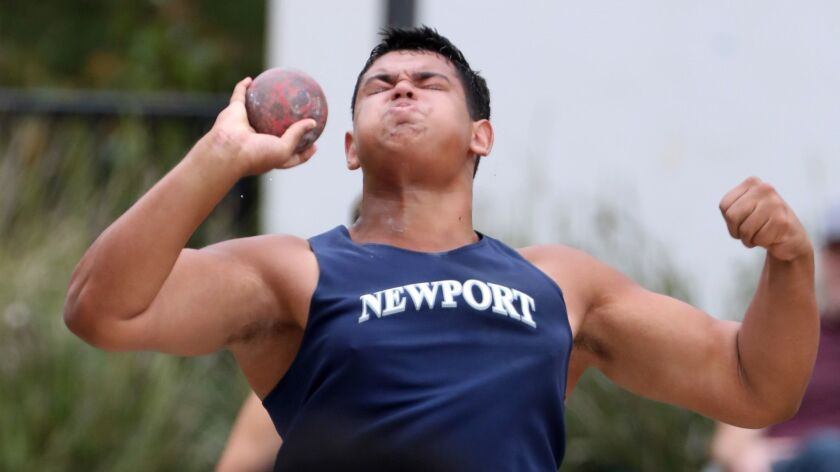 Newport Harbor High School Aidan Elbettar throws the shot put in the Division 2 boys shot-put event