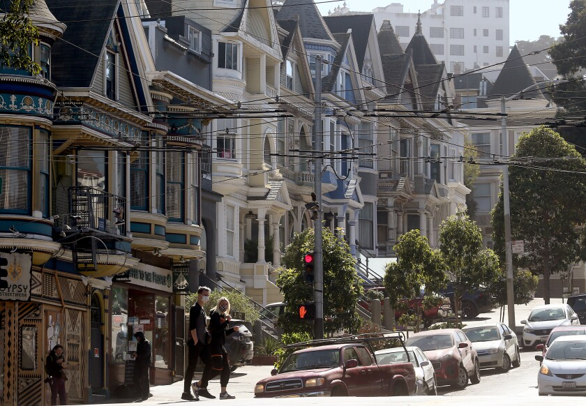 Pedestrians wear masks as they walk along Haight Street in San Francisco in October.