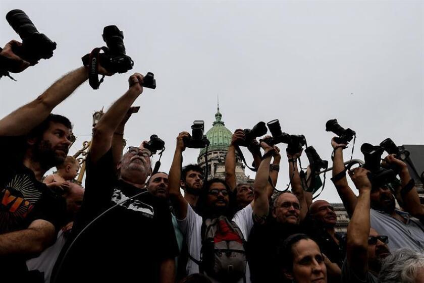 Photographers and journalists in Buenos Aires raise their cameras in protest this Friday, Feb. 22, 2019, against the arrest of photojournalists Bernardino Avila and Juan Pablo Barrientos while they were covering a demonstration last Wednesday. EFE-EPA/Juan Ignacio Roncoroni