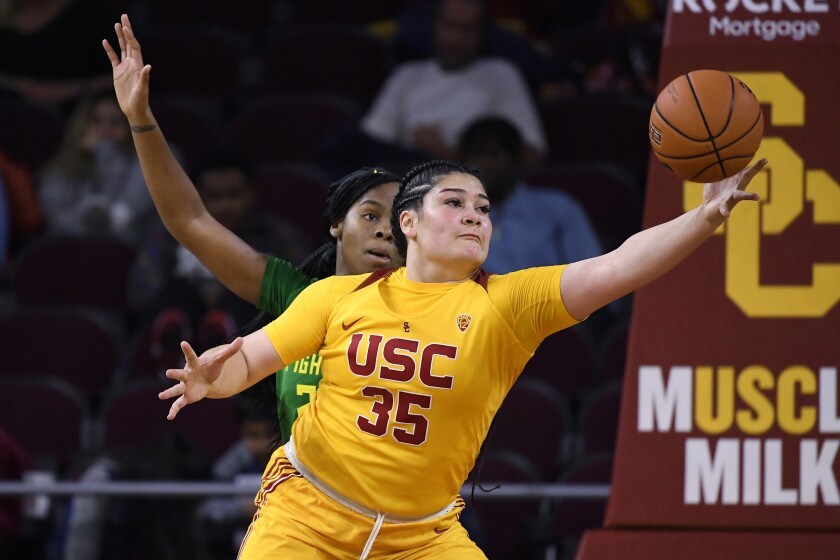 USC forward Alissa Pili, right, grabs a pass in front of Oregon forward Ruthy Hebard defends during the Ducks' 93-67 win Sunday.