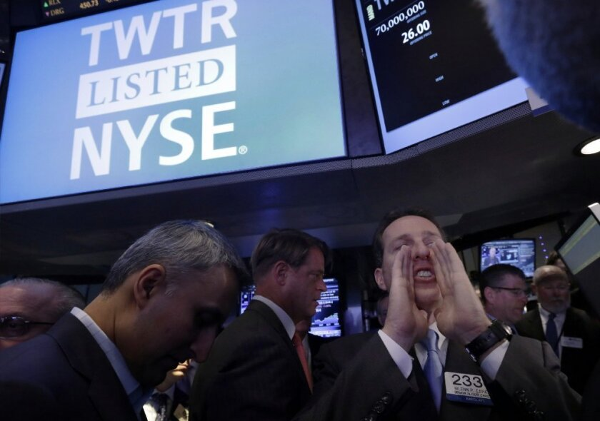 Specialist Glenn Carell calls out prices before Twitter begins trading during its IPO, on the floor of the New York Stock Exchange, on Nov. 7.
