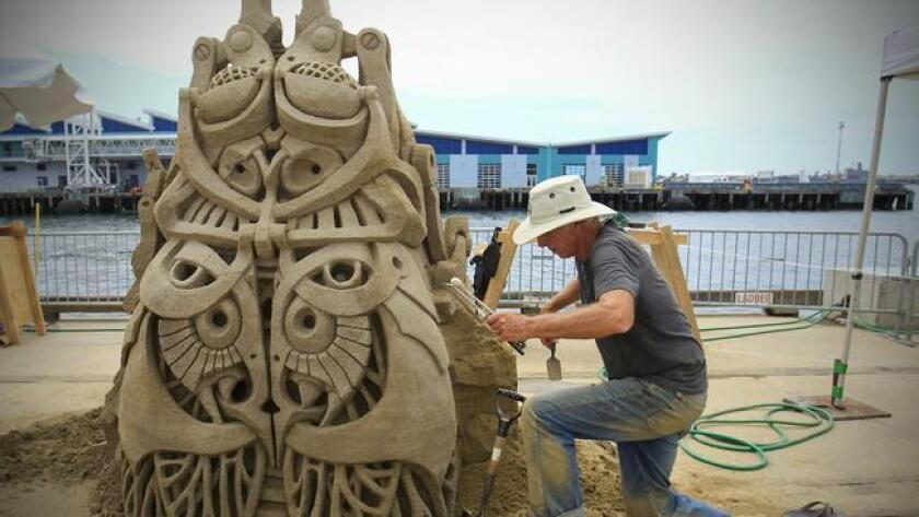 Kirk Rademaker works on his entry, Bug on a Rug, in the U. S. Sand Sculpting Challenge in 2013. (Howard Lipin)