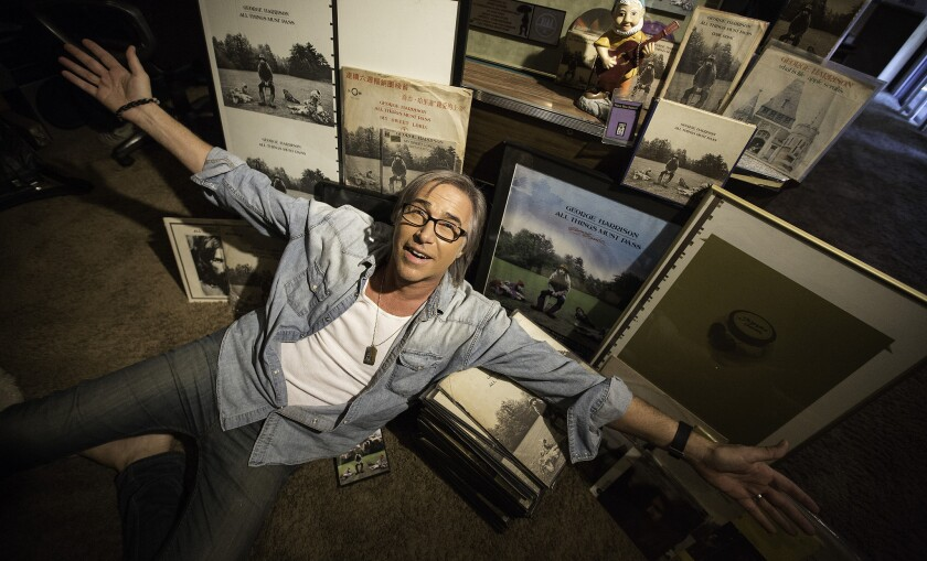 """Chris Carter, host of KLOS and Sirius Radio's """"Breakfast with the Beatles,"""" with his extensive collection of versions of George Harrison's 1970 solo album, """"All Things Must Pass,"""" at his home in Sherman Oaks on Oct. 21, 2015."""
