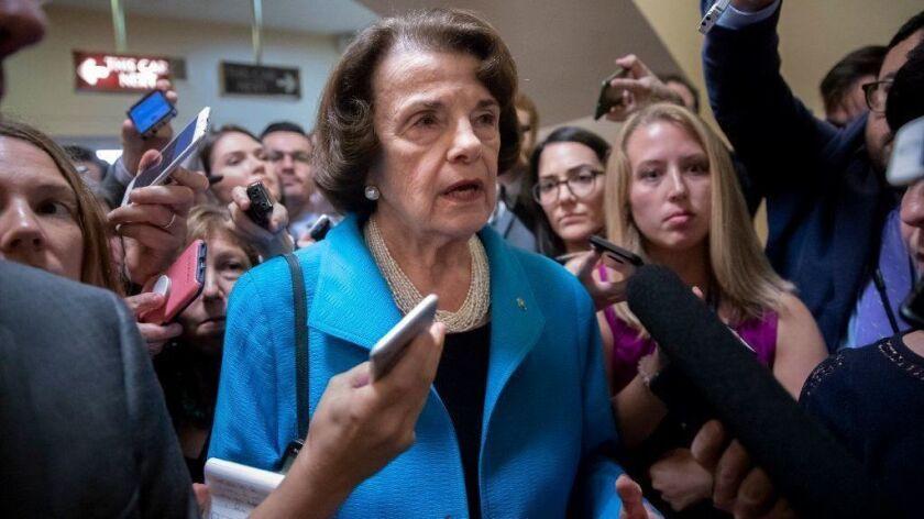 Sen. Dianne Feinstein talks to members of the media on Capitol Hill on Sept. 18, 2018.