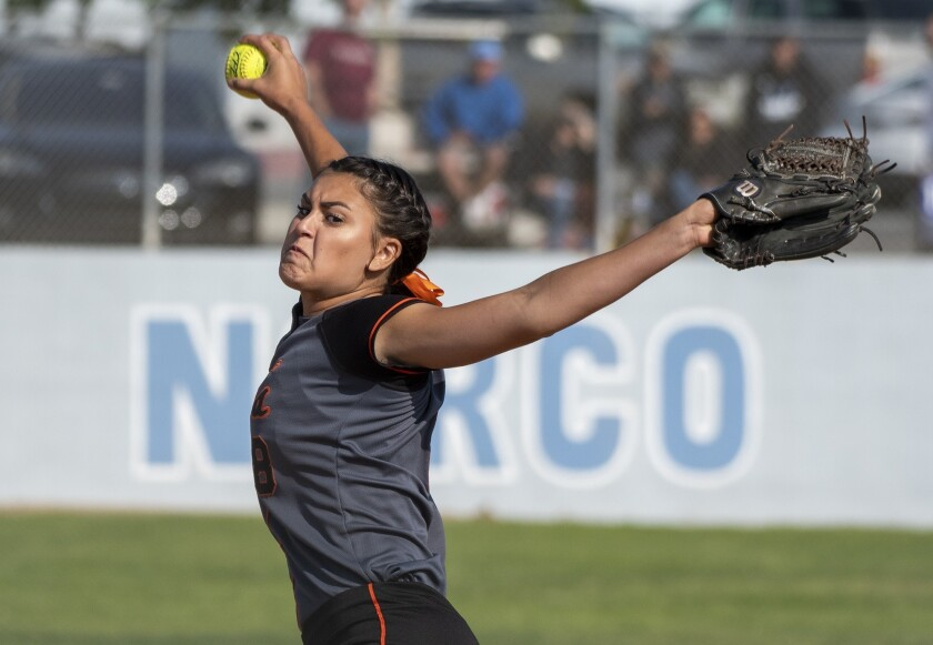 Huntington Beach's Grace Uribe pitches during a quarterfinal CIF Southern Section Division 1 playoff