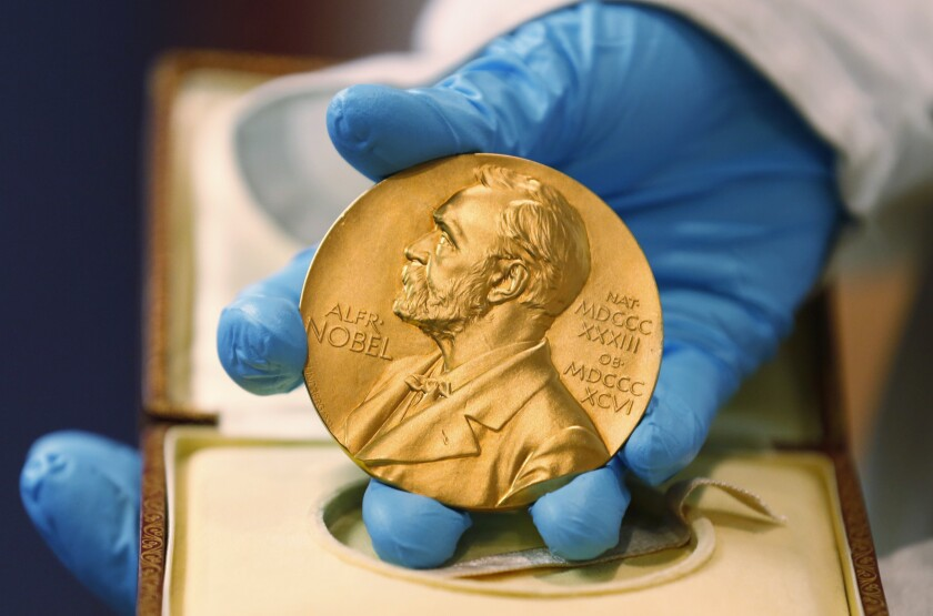 A gold Nobel Prize medal.