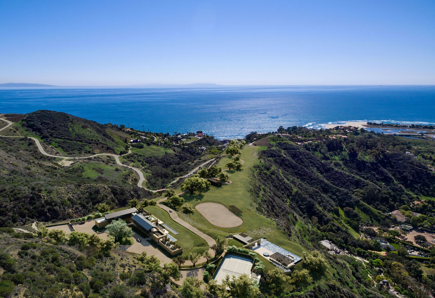 Spanning 38 acres overlooking the ocean, the undeveloped estate includes approved plans for a 12,000-square-foot modern mansion.