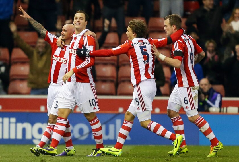 Stoke City's Stephen Ireland, left, celebrates scoring against Chelsea during the English Premier League soccer match at the Britannia Stadium, Stoke, England, Saturday. Dec. 7 2013. (AP Photo/Dave Thompson, PA Wire) UNITED KINGDOM OUT - NO SALES - NO ARCHIVES