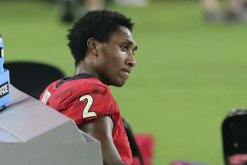 FILE - In this Nov. 7, 2020, file photo, Georgia quarterback D'Wan Mathis looks on from the bench after throwing an interception in the final seconds of an NCAA college football game against Florida in Jacksonville, Fla. Mathis, who opened the season as No. 11 Georgia's starter before losing his job, has entered the NCAA transfer portal. Coach Kirby Smart confirmed the transfer decision by Mathis on Monday, Nov. 30, 2020, as the Bulldogs opened practice for Saturday's visit from Vanderbilt. (Curtis Compton/Atlanta Journal-Constitution via AP, File)