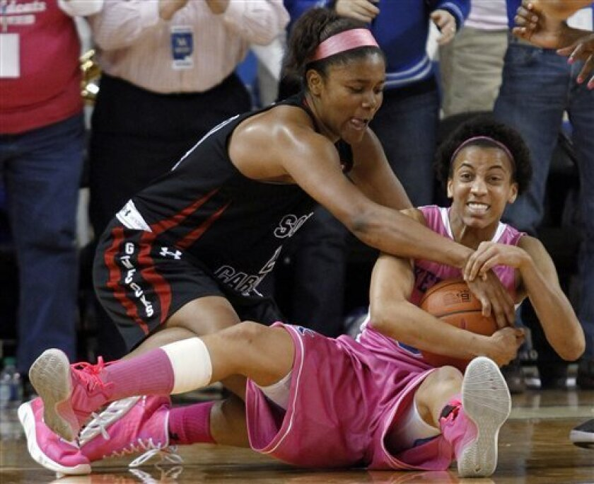 Kentucky's Kastine Evans, right, pulls in a loose ball next to South Carolina's Ashley Bruner during the second half of an NCAA college basketball game at Memorial Coliseum in Lexington, Ky., Thursday, Feb. 14, 2013. Kentucky defeated South Carolina 78-74. (AP Photo/James Crisp)
