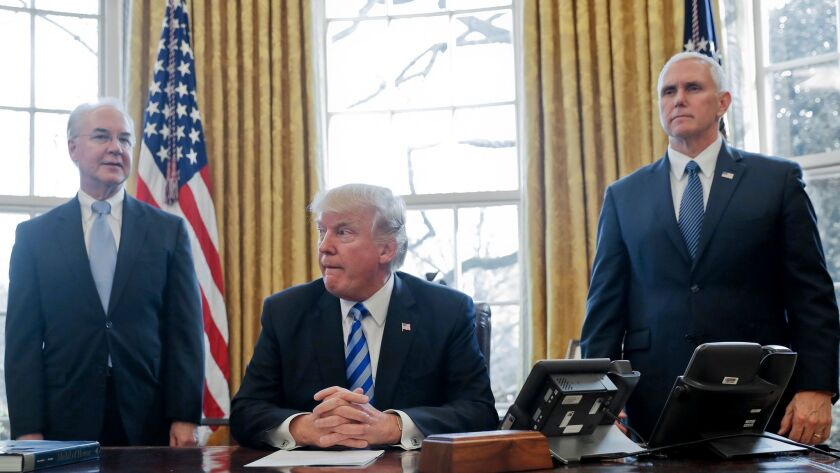 President Donald Trump, flanked by Health and Human Services Secretary Tom Price, left, and Vice Pre
