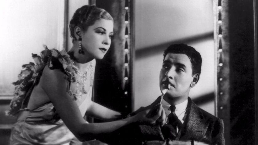 "Ronald Colman and Joan Bennett in ""Bullfrog Drummond."""