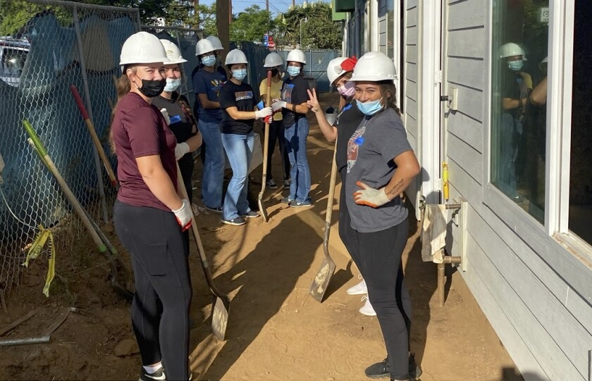 Students from the University of Saint Katherine in San Marcos helped build homes with Habitat for Humanity in National City.