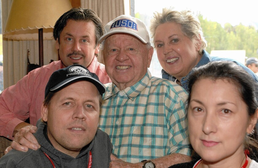 Mickey Rooney with his family, clockwise from upper left, son Chris, wife Jan, daughter-in-law Charlene and son Mark.