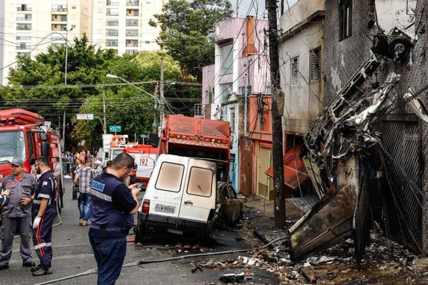 A view of the scene on a street in Sao Paulo following the crash of a small plane shortly after takeoff from a nearby executive airport on Friday, Nov. 30. EFE-EPA/Marcelo Chello