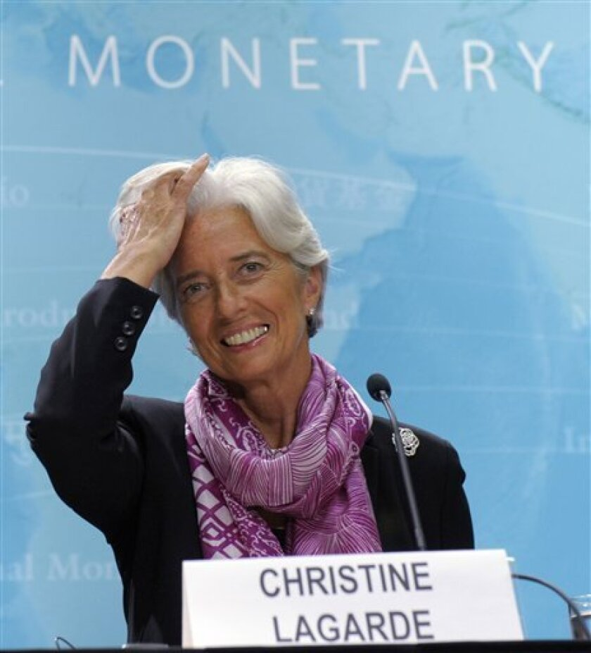 New International Monetary Fund (IMF) Managing Director Christine Lagarde gestures during her first news conference at the IMF in Washington, Wednesday, July 6, 2011. (AP Photo/Susan Walsh)