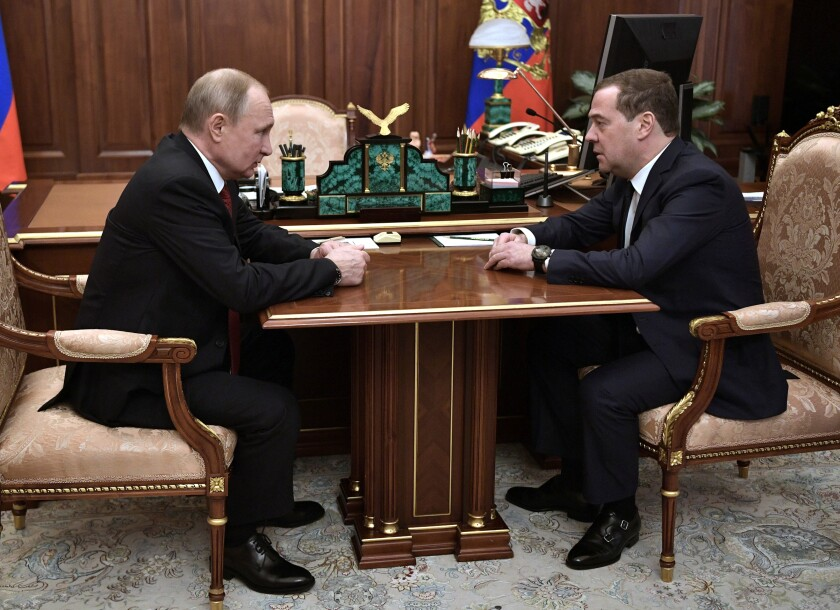 Russian President Vladimir Putin, left, listens to Russian Prime Minister Dmitry Medvedev during their meeting in the Kremlin in Moscow, Russia, Wednesday, Jan. 15, 2020. (Alexei Nikolsky, Sputnik, Kremlin Pool Photo via AP)