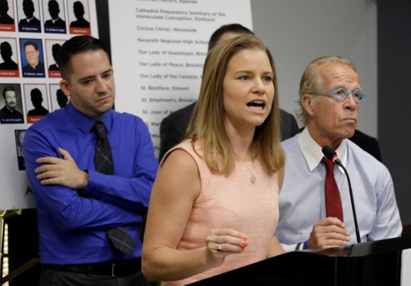 Sexual abuse victim Bridie Farrell (C) addresses the media during a news conference alongside sexual abuse victim Joseph Caramanno (L) and attorney Jeff Anderson (R) to announce over 200 sex abuse lawsuits against members of the clergy in New York, New York, USA, 14 August 2019. EFE/EPA/Jason Szenes