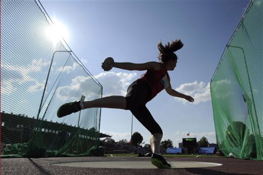 Stephanie Brown Trafton from the US competes during the discus event at the Athletissima IAAF Diamond League international athletics meeting in the Stade Olympique de la Pontaise in Lausanne, Switzerland, on Thursday, June 30, 2011. (AP Photo/Keystone, Jean-Christophe Bott) GERMANY OUT - AUSTRIA OU