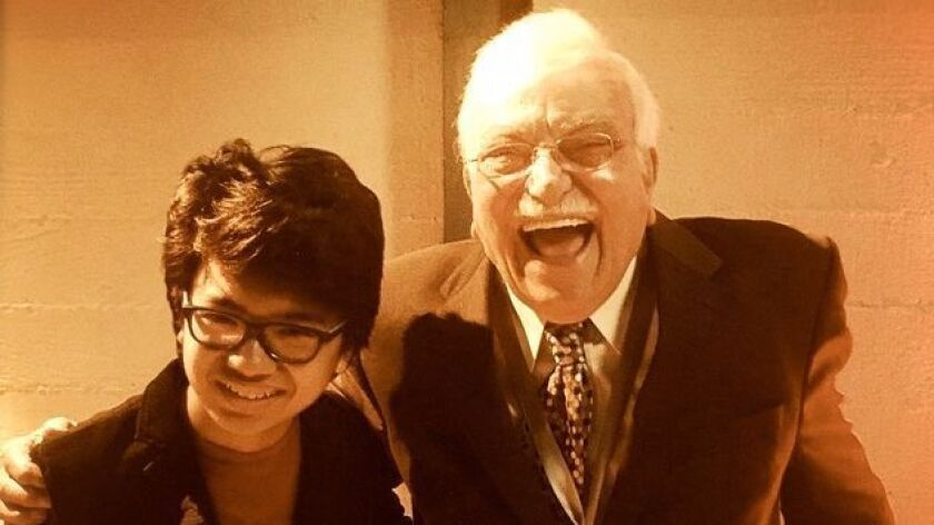 Joey Alexander, 13, and San Diego's Sammy Nestico, 93, are shown at Saturday's reception for 2017 Grammy Awards' nominees in Los Angeles.
