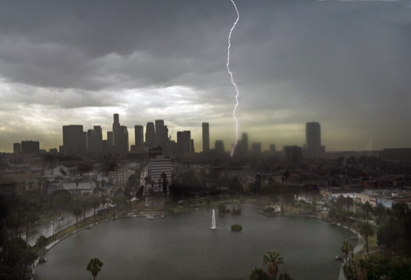 Lightning splits the sky in downtown Los Angeles early Saturday in this view from the American Cement Building overlooking MacArthur Park Lake.