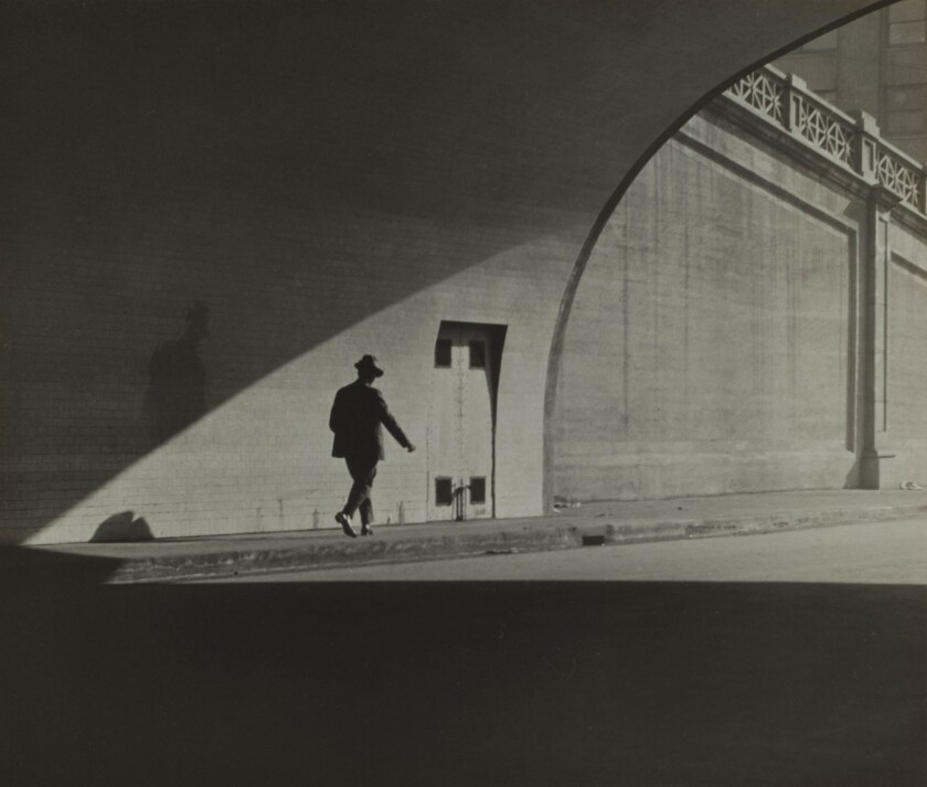 """The Japanese American National Museum in Los Angeles is showing the work of early 20th century photographers, including J.T. Sata's image """"Untitled (Man Walking Out of Tunnel),"""" c. 1930, above."""