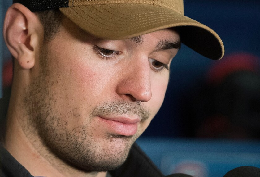FILE - Montreal Canadiens goaltender Carey Price speaks to reporters during an end of season news conference in Brossard, Quebec, in this Monday, April 9, 2018, file photo. Canadiens goaltender Carey Price has voluntarily entered the NHL/NHL Players' Association joint player assistance program, a stunning announcement Thursday, Oct. 7, 2021, less than a week before the season begins and just three months after he backstopped Montreal to the Stanley Cup Final.(Graham Hughes/The Canadian Press via AP, File)