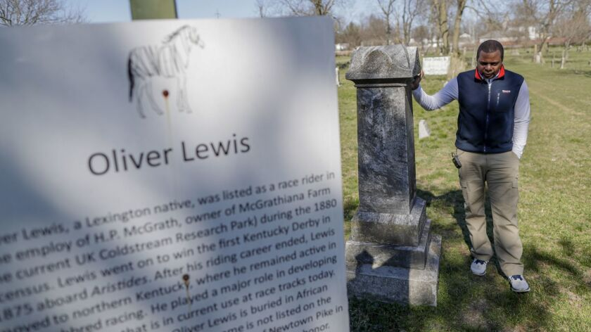 LEXINGTON, KENTUCKY, SUNDAY, MARCH 17, 2019 - Leon Nichols, 51, stands next to the family headstone
