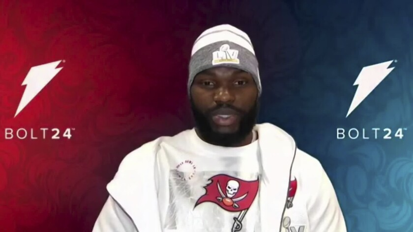In this still image from video provided by the NFL, Tampa Bay Buccaneers outside linebacker Shaquil Barrett (58) speaks during Opening Night for the NFL Super Bowl 55 football game Monday, Feb. 1, 2021. (NFL via AP)