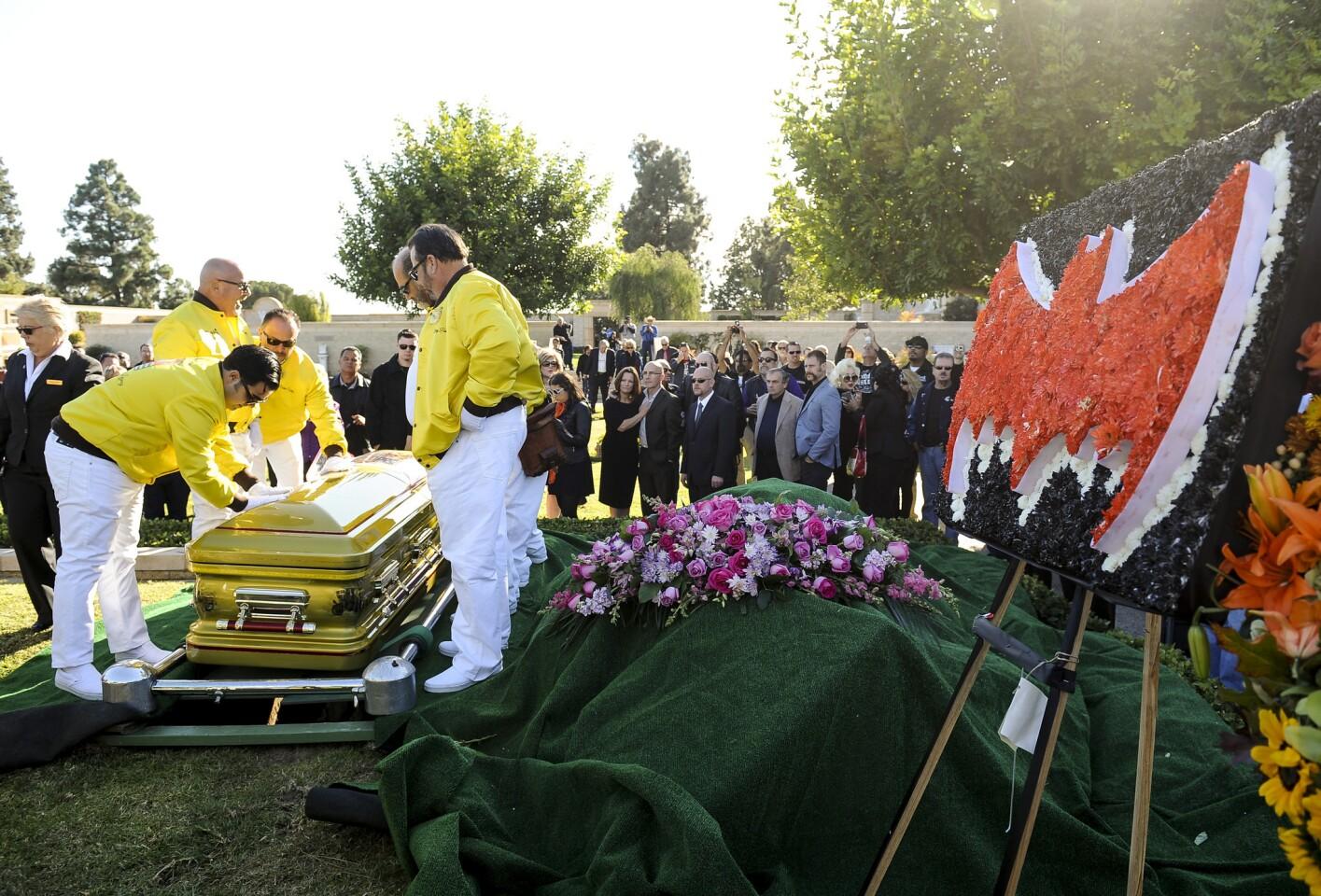 Pallbearers set George Barris' custom-painted casket down at Forest Lawn Glendale on Saturday. Barris died Nov. 5 at his Encino home.