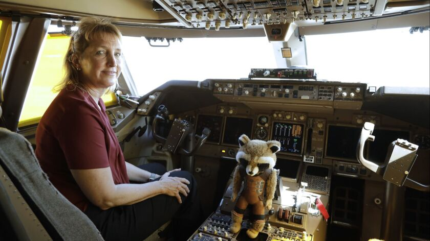 "MOJAVE, CA -- JUNE 14, 2019: Kelly Latimer inside the cockpit of ""Cosmic Girl,"" the modified 747 pla"
