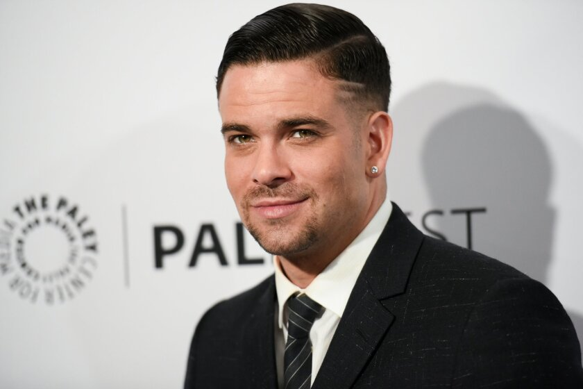 "FILE - In this March 13, 2015 file photo, Mark Salling arrives at the 32nd Annual Paleyfest ""Glee"" held at The Dolby Theatre in Los Angeles. Salling, who played bad-boy Noah ""Puck"" Puckerman on the Fox musical dramedy ""Glee,"" was charged Friday, May 27, 2016, with receiving and possessing child por"