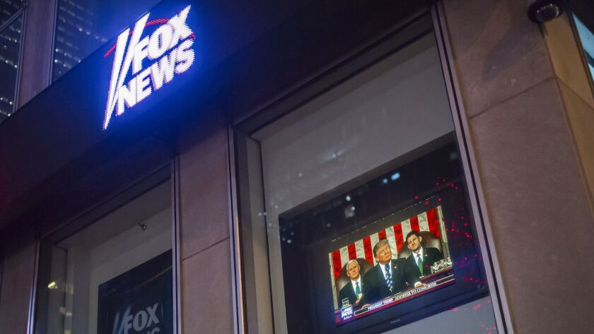The News Corp. building in Midtown Manhattan in New York shows the Fox News broadcast.