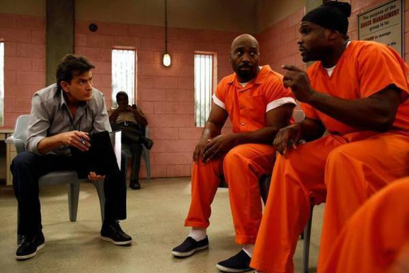 "Charlie Sheen, left, with James Black and Darius McCrary, right, in a scene from the new comedy ""Anger Management."""