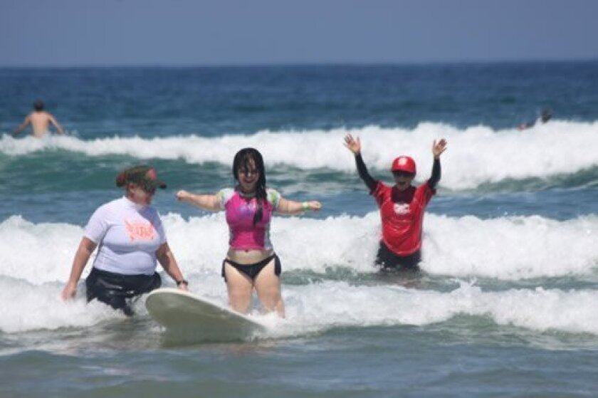 Erin Slack, from Illinois, surfs for the first time at La Jolla Shores.