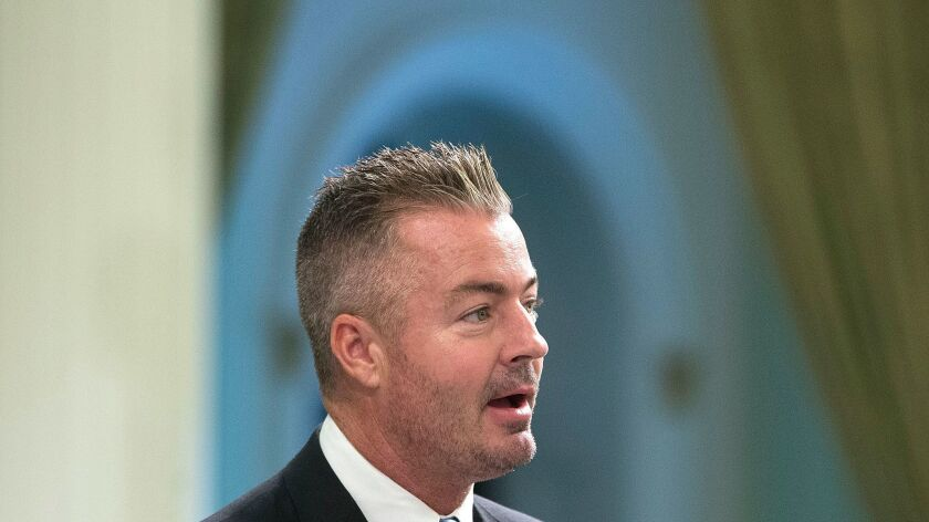 California Assemblyman Travis Allen (R-Huntington Beach) addresses the Assembly in Sacramento in 2016. He is the organizer of a campaign to repeal the gas tax increase.