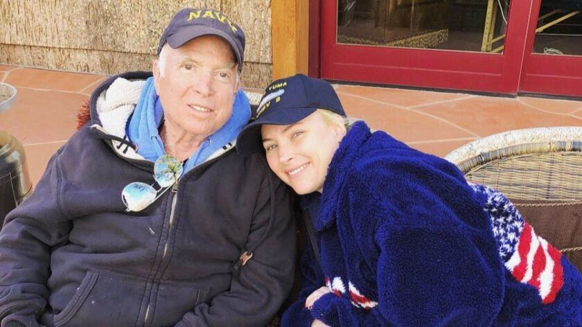 This Sunday, March 18, 2018 photo provided by Meghan McCain show Meghan McCain and her father U.S. S