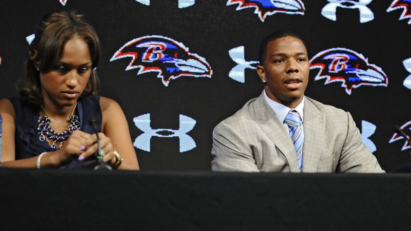 Ray Rice sits next to his wife, Janay, at a news conference in May 2014. Rice's domestic violence case sparked some changes to the way sports leagues disciplined athletes accused of domestic assault.