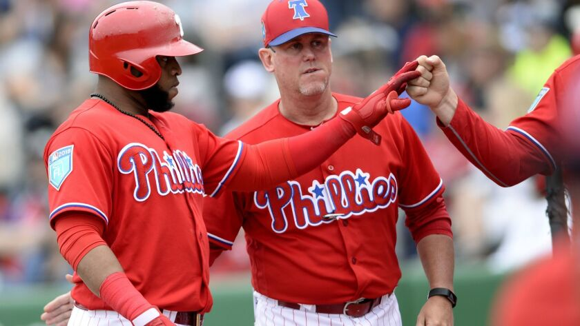 Philadelphia Phillies Carlos Santana (41) is congratulated after his RBI sacrifice fly during the fi