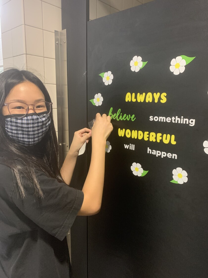 Girl Scout Vicky Xu helps put out a positive message at Solana Ranch.