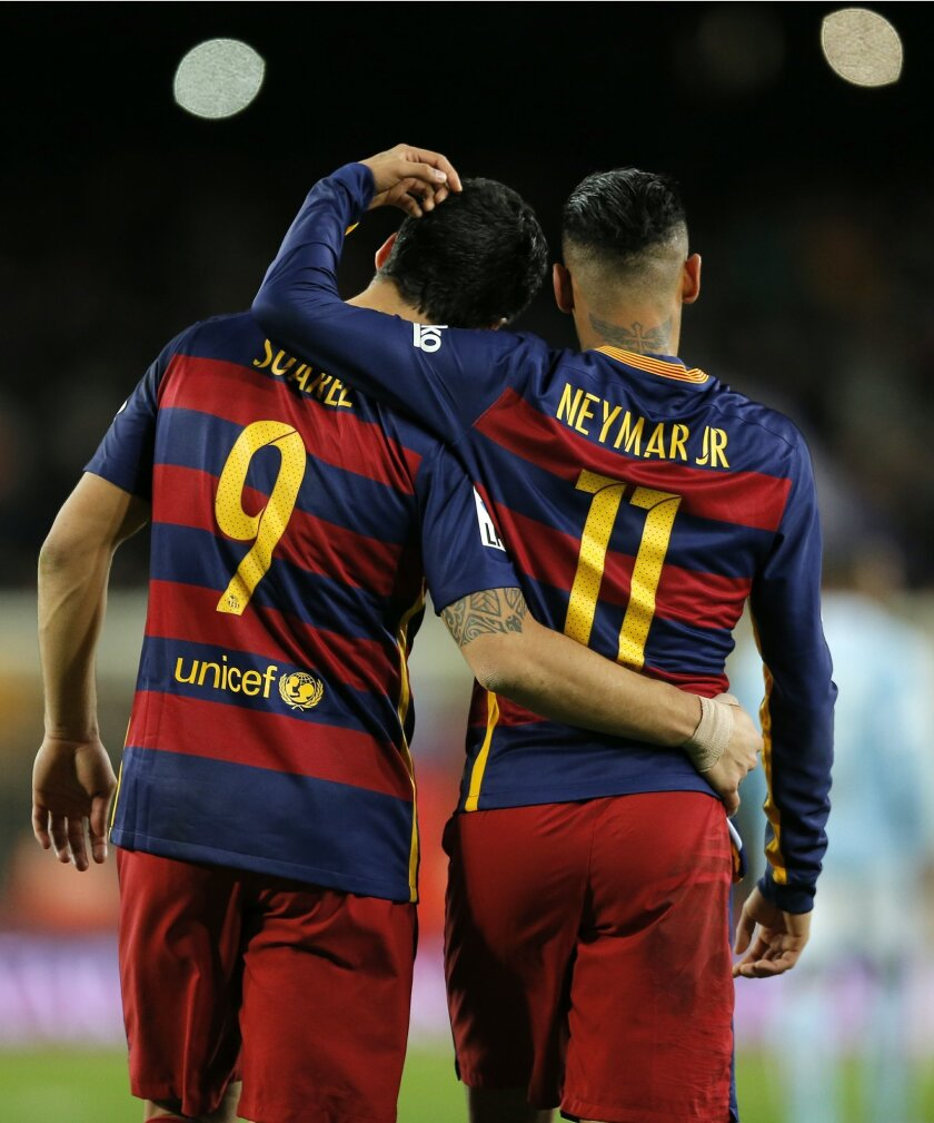 FC Barcelona's Neymar, right, celebrates with his teammate Luis Suarez a goal against Celta Vigo during a Spanish La Liga soccer match at the Camp Nou stadium in Barcelona, Spain, Sunday, Feb. 14, 2016. (AP Photo/Manu Fernandez)