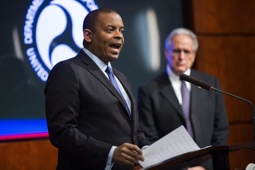 Transportation Secretary Anthony Foxx, left, with National Highway Traffic Safety Administration chief Mark Rosekind in Washington in November, announces fines against the maker of defective airbags.