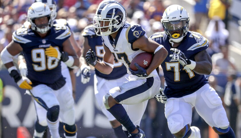 LOS ANGELES, CA, SUNDAY, SEPTEMBER 23, 2018 - Chargers defenders chase Rams receiver Robert Woods on